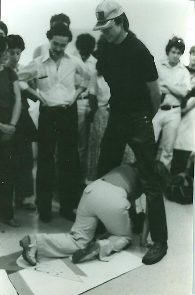 A Ray Johnson performance during which he asks participants to walk through each others legs, 1980. Photographer unknown