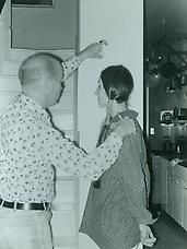 Ray Johnson measuring the silhouette of a woman, c.1976. Photographer unknown