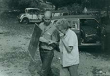 Ray Johnson with Sari Dienes stealing back his work, Robin Gallery event, 1963. Photo by William S. Wilson