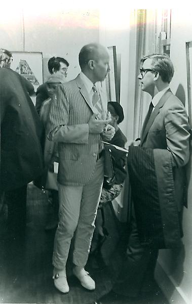 Ray Johnson at the opening of one of his shows at the Willard Gallery. Arakawa is in the background. April, 1965. Photo by William S. Wilson
