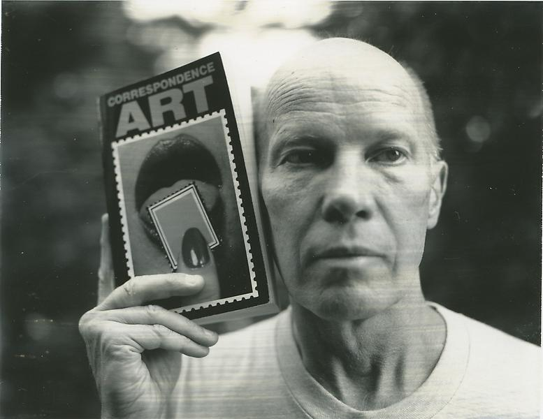 Ray Johnson with Michael Crane's and Mary Stofflet's Correspondence Art book, San Francisco 1984. Photograph by Michael E. Ach. - Ray_JohnsonPortrait10