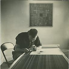 Ray Johnson at work on unknown painting with his piece Calm Center on the wall behind him, ca. 1948-52. Photographer Unknown