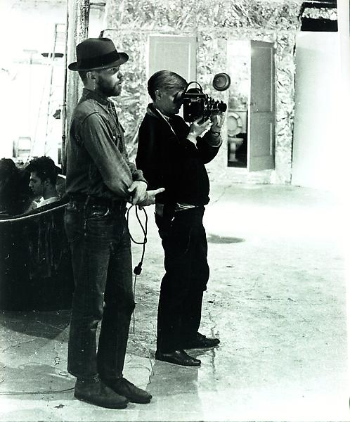 Ray Johnson with Andy Warhol at the Factory, 1964. Photo by Billy Name