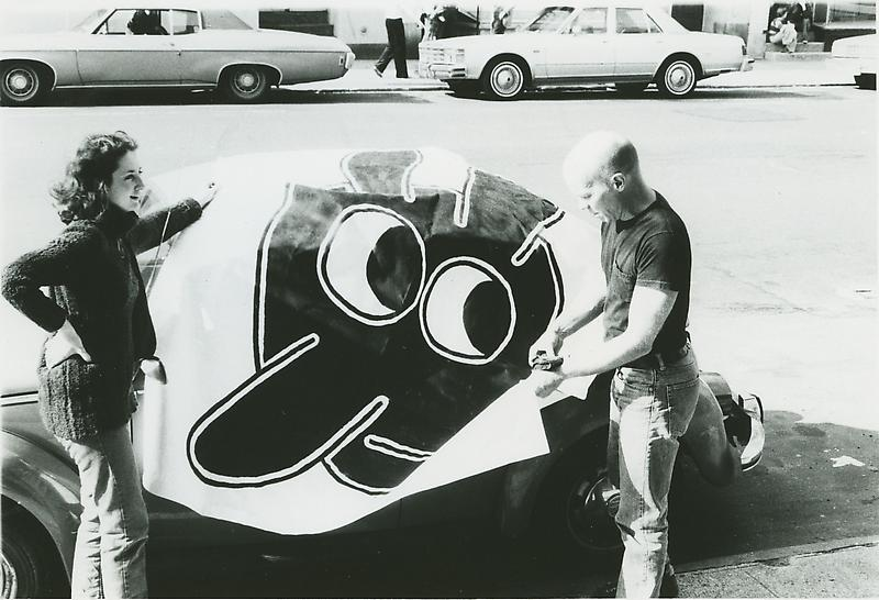 Ray Johnson with banner made for his solo exhibition, Goldie Paley Gallery, Moore College of Art, Philadelphia 1991. Photographer unknown